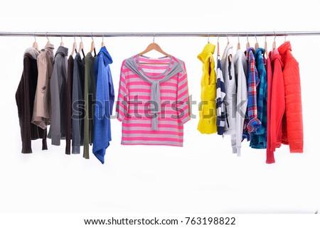 Mix color row of female,coat ,jacket ,sundress on hanging    #763198822