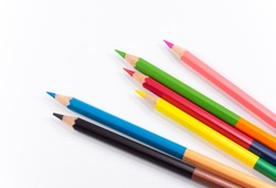 Mix colorful pencils on white background. Two colors in one pencil for drawing.