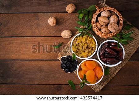 Mix dried fruits (date palm fruits, prunes, dried apricots, raisins) and nuts, and traditional Arabic tea. Ramadan (Ramazan) food. Top view #435574417