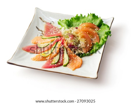 Mix from fish meat, cucumber, cabbage, tomato and salad strewed with sesame grain on the squared plate over white background