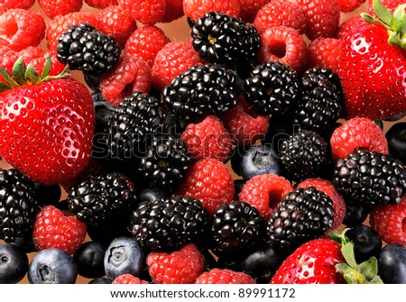 Mix from fresh berries on a table, a bilberry, a raspberry, a strawberry