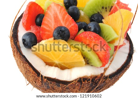 Mix fruit salad closeup, isolated white background. Healthy eating, dieting concept.