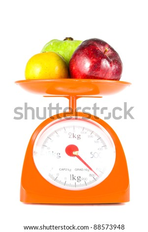 mix fruits lying on weight scale - stock photo