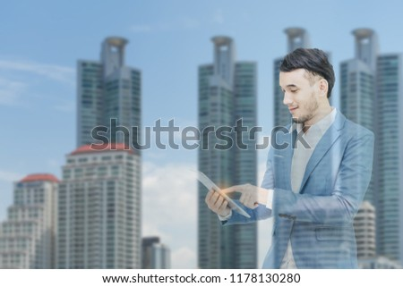 Mix image.Business man holding smartphone in hand with background city view. #1178130280
