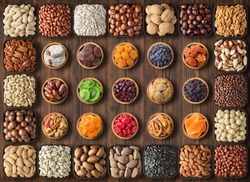 mix nuts and dried fruit on table background