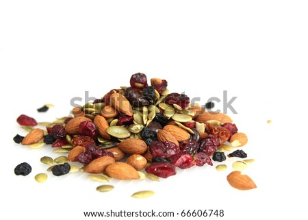 Mix nuts, dry fruits and chocolate on a white background