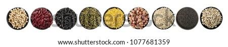 Mix nuts in black bowl on white background ,soy bean,green beans,red bean,black bean,peeled mung bean,peanut,barley,black sesame,pivot seeds