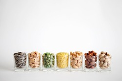 Mix Nuts in the glass on white background , close up nuts , pistachios almond cashew nuts peanut sunflower seeds
