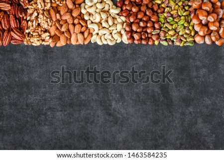 Mix nuts like walnut, pistachio, almond, pecan, cashew, hazelnut. Copy space. Various nut banner.