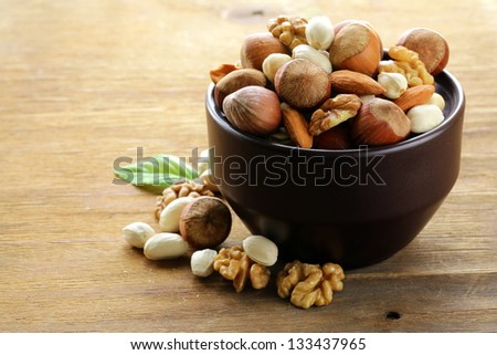 mix nuts - walnuts, hazelnuts, almonds on a wooden table