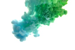 Mix of abstract blue and green ink in water on a white background. It looks like smoke or cloud. Or zero gravity.