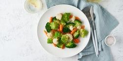 Mix of boiled vegetables. Broccoli, carrots, cauliflower. Steamed vegetables for dietary low-calorie diet. FODMAP, dash diet, vegan, vegetarian, top view