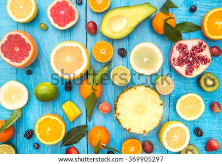 Shutterstock Mix of colored fruits on white wooden background - Composition of tropical and mediterranean fruits - Concepts about decoration, healthy eating and food background