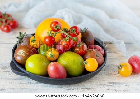 Mix of different varieties of tomato for cooking your favorite salads and snacks, your own garden and harvest, cherry red and yellow, a variety of kiwi #1164626860