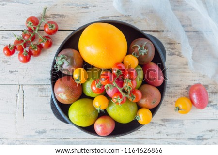 Mix of different varieties of tomato for cooking your favorite salads and snacks, your own garden and harvest, cherry red and yellow, a variety of kiwi #1164626866