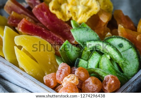 Mix of dried and sun-dried fruits, dried fruits in a wooden box