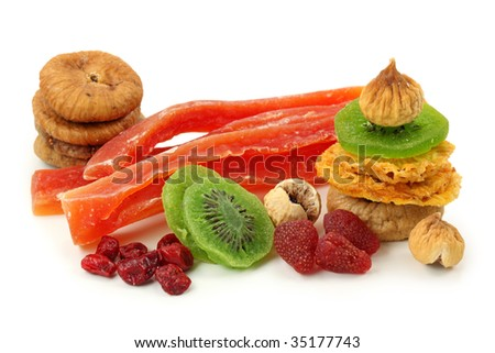 Mix of dried fruits isolated on white background