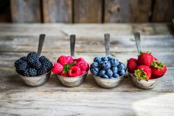 Mix of fresh berries on rustic background