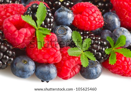 mix of fresh berries on the white - stock photo
