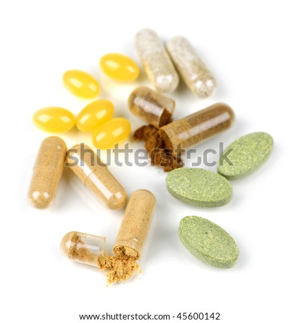 Mix of  herbal supplements and vitamin pills isolated on white - stock photo