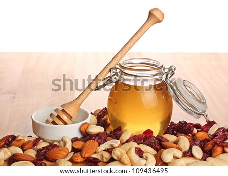 Mix of kernel And A Jar Of Golden Light Honey With A Honey Dipper