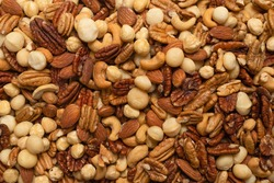 Mix of nuts as a background. Top view.