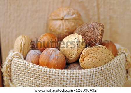 mix of nuts in burlap bag on wooden shelf