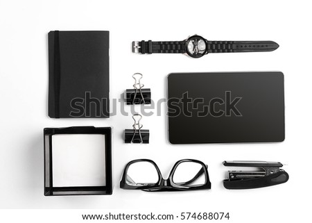 Mix of office supplies and business gadgets on a modern  desk stock photo
