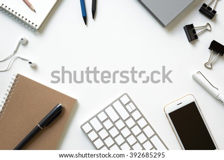 Mix of office supplies and business gadgets on a modern office desk