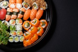 Mix of sushi and rolls macro. Japanese traditional food. Dishes from raw fish