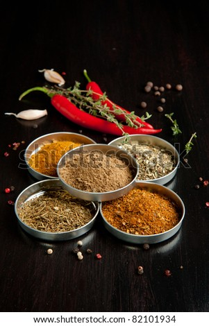 Mix of the spices and red hot chili peppers on black table
