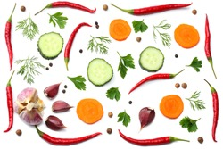 mix red hot chili peppers with parsley and sliced cucumber and garlic isolated on white background top view