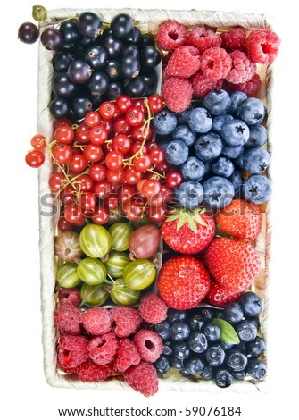 mix ripe berries in the basket isolated on a white