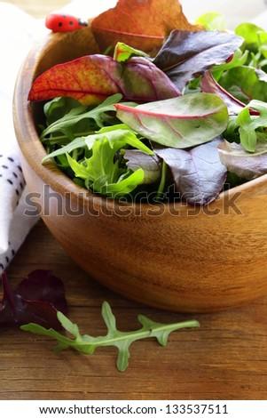 mix salad (arugula, iceberg, red beet) in a bowl