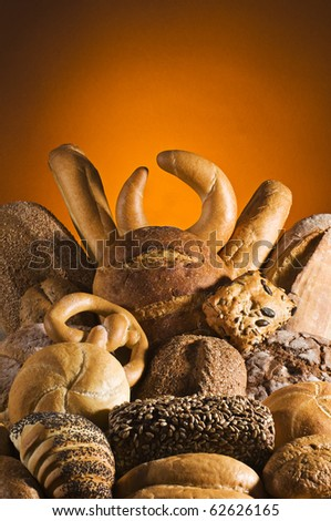 Mixed bread with orange background close up