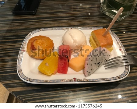 Stock Photo Mixed break snacks on plate that pick from the buffet bar.