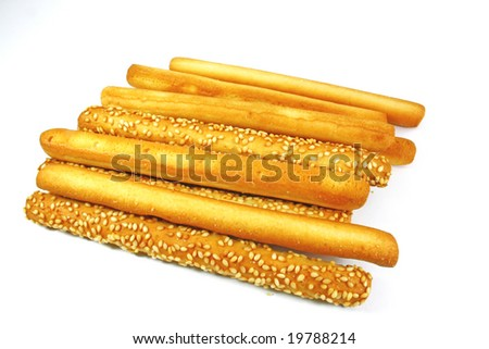 mixed butter and sesame bread sticks isolated on white background