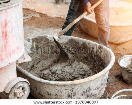 Mixed cement in the basinBy manual workers