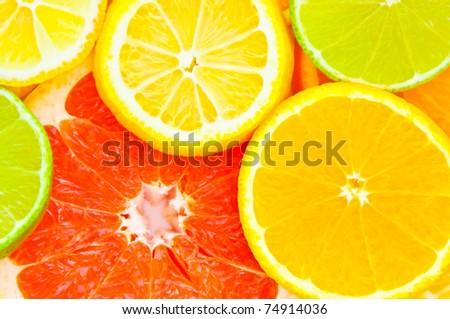 Mixed citrus fruit. Lemon, Lime, Orange, Grapefruit - stock photo