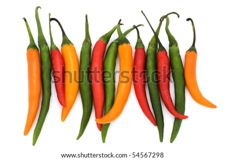 mixed colored chilli peppers on a white background