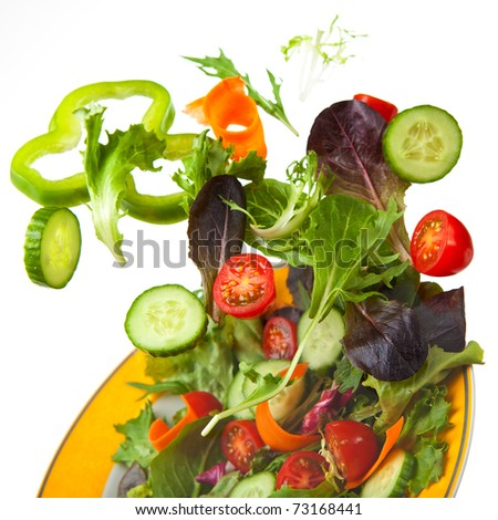 Mixed Crisp Salad being tossed in the air