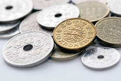 Mixed Danish Coins with selective focus - The krone is the official currency of Denmark, Greenland, and the Faroe Islands.