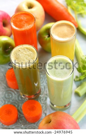 mixed detox fruit and vegetable juice. There are celery, carrot, apple, pineapple.