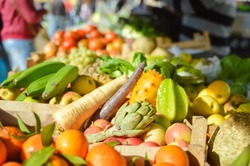 Mixed exotic fruits and vegetables on farmers market stall