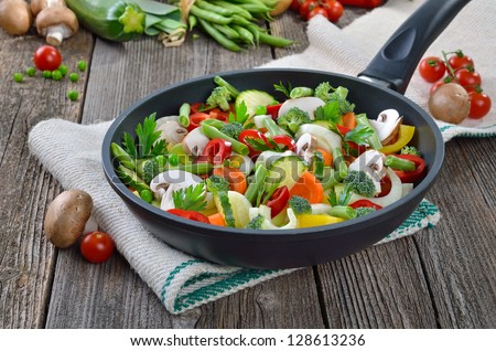 Mixed fresh vegetables in a skillet