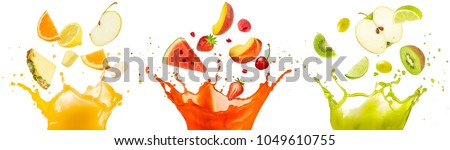 Photo of  mixed fruit falling into juices splashing on white background