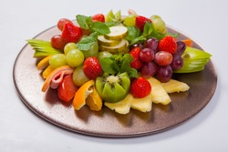 Mixed Fruit platter with assorted fruits on a white background.