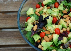 Mixed green salad with vegetables and nuts