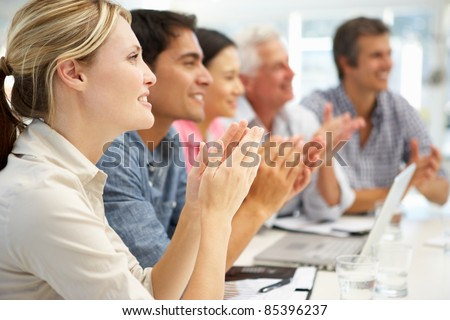 Mixed group in business meeting - stock photo