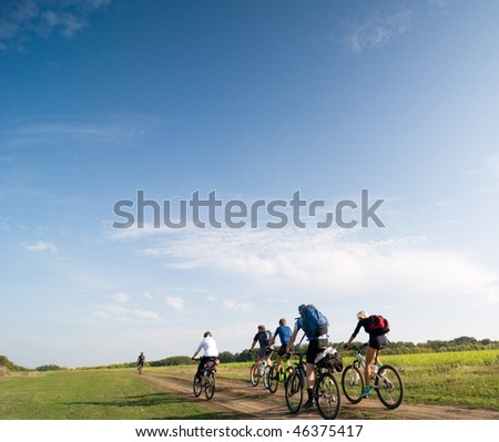 mixed group of cyclists biking